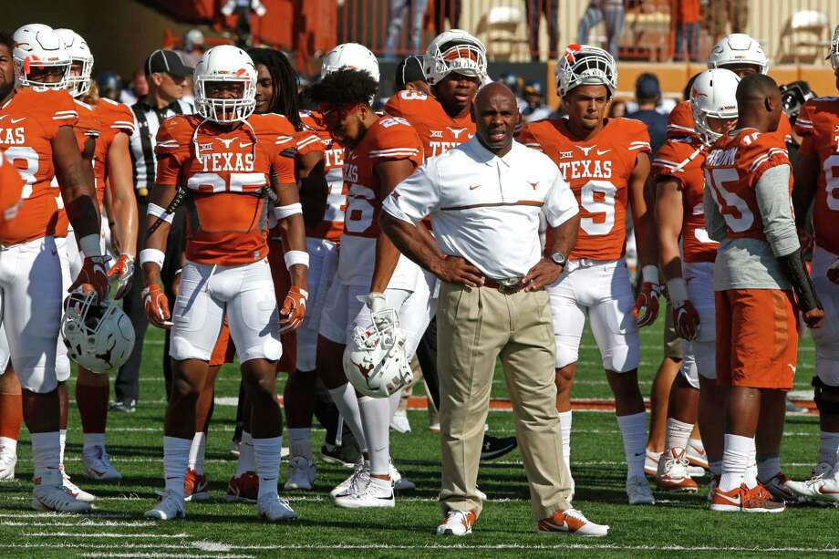 Texas head coach Charlie Strong stands with his players before the start of an NCAA college football game against West Virginia, Saturday, Nov. 12, 2016, in Austin, Texas. Photo: Michael Thomas, Associated Press / FR65778 AP