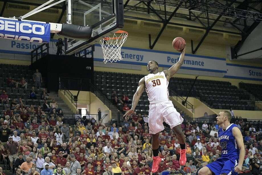 Iowa State guard Deonte Burton goes up for a dunk in front of Indiana State forward Matt Van Scyoc. Photo: Phelan M. Ebenhack, Associated Press