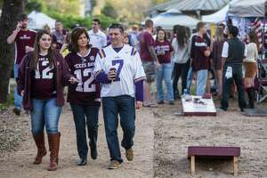 Texas A&M and LSU fans tailgate before an NCAA football game between Texas A&M and LSU at Kyle Field on Thursday, Nov. 24, 2016, in Houston.