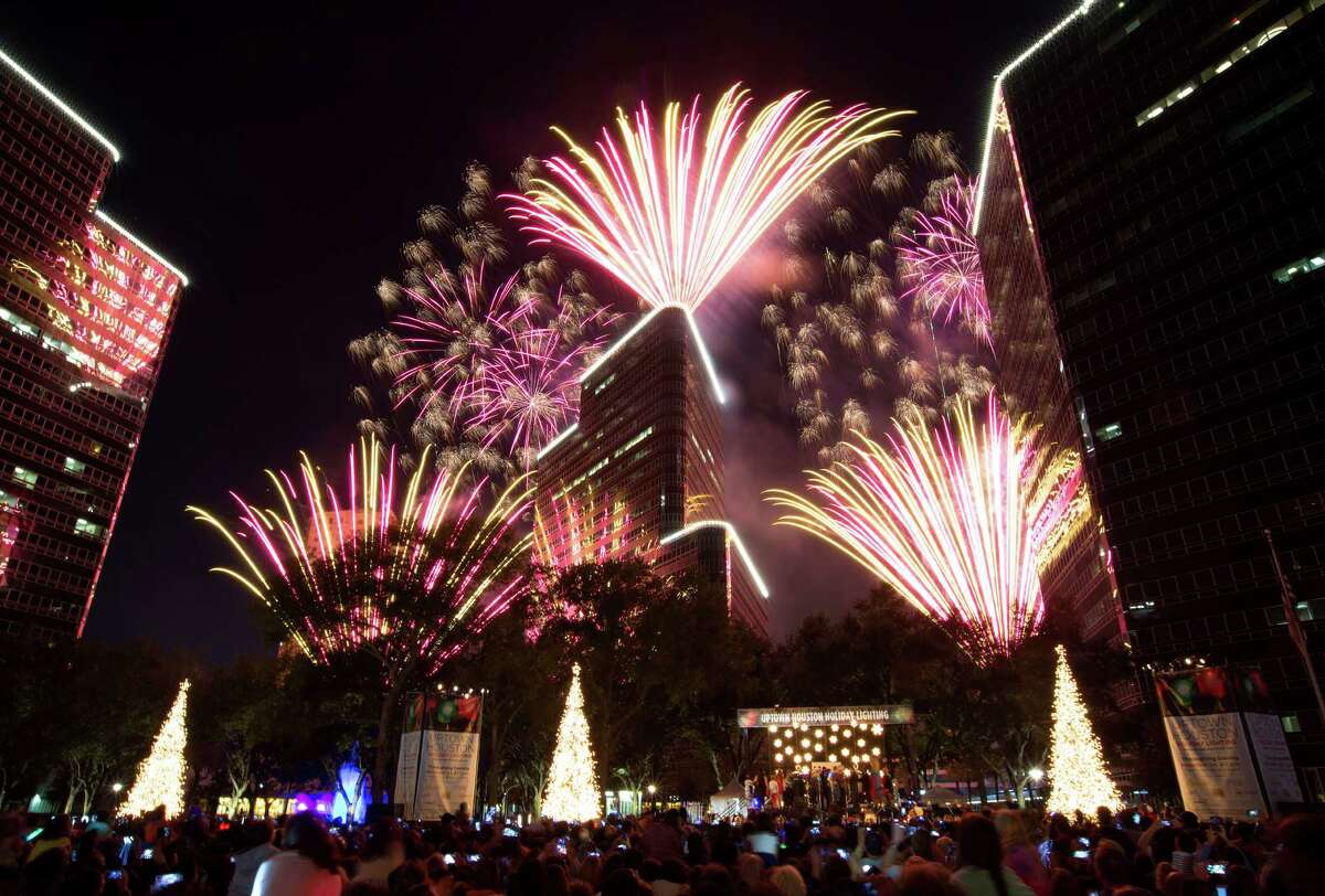 Fireworks explode to the delight of the crowd filling Post Oak Boulevard at the conclusion of the Uptown Houston Holiday Lighting celebration, Thursday, Nov. 24, 2016, in Houston.