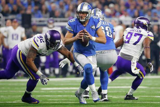 Detroit Lions quarterback Matthew Stafford (9) scrambles away from Minnesota Vikings defensive tackle Tom Johnson (92) during the first half of an NFL football game, Thursday, Nov. 24, 2016, in Detroit. (AP Photo/Rick Osentoski) ORG XMIT: DTF104