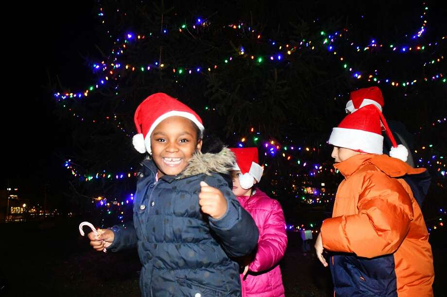 Honest Webster, 6, dances at the sight of the newly lit tree during the Jackie Robinson Park of Fame's Annual Christmas Tree Lighting in Stamford, Conn., Nov. 22, 2016. The Project Music Rhapsody Ensemble and Choir performed songs and Santa Claus made the scene too. Photo: Keelin Daly / For Hearst Connecticut Media / Stamford Advocate freelance