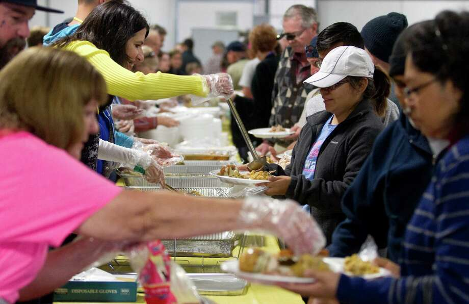 Hundreds received a hot meal during the Montgomery County Thanksgiving Outreach dinner at the Montgomery County Fair Grounds Thursday, Nov. 24, 2016, in Conroe. Photo: Jason Fochtman, Staff Photographer / Houston Chronicle