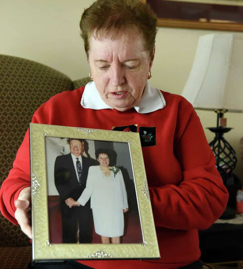 Beverly Messick holds a photograph of her and husband Thomas Messick, who disappeared without a trace at age 82 while hunting at her home Wednesday Nov. 23, 2016 in Brunswick, NY. (John Carl D'Annibale / Times Union)