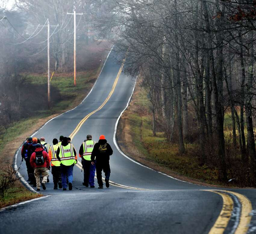 Searchers walk west on Burgoyne Road during the continuation of the search for the missing Fred Drumm Friday morning Nov. 27, 2015, in Schuylerville, N.Y. (Skip Dickstein/Times Union archive)