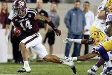 Texas A&M defensive back Justin Evans (14) breaks away from LSU wide receiver Russell Gage (39) on a kick return during the first quarter of an NCAA football game at Kyle Field on Thursday, Nov. 24, 2016, in Houston.