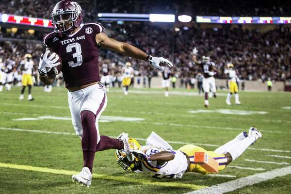 Texas A&M wide receiver Christian Kirk (3) breaks past LSU safety John Battle (26) for a 36-yard touchdown reception during the first quarter of an NCAA football game at Kyle Field on Thursday, Nov. 24, 2016, in Houston.