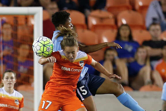 Dash midfielder Andressa (17) battles Sky Blue FC forward Maya Hayes this season. Coach Randy Waldrum wants Andressa in a more attacking role.
