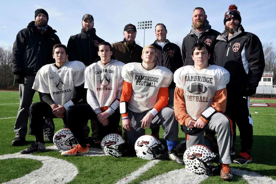 Captains and coaches of the Cambridge football team on Wednesday, Nov 23, 2016, at Stillwater High in Stillwater, N.Y. Front row, from left, are team captains Lucas Winchester, Shawn Lemieux, Noah Nemier and Ryan McLenithan.  Second row, from left are coaches Derek Srygley, Adam Burr, Dan Severson, Doug Luke (head coach), Chad Burr and Tony Bochette. (Cindy Schultz / Times Union) Photo: Cindy Schultz / Albany Times Union