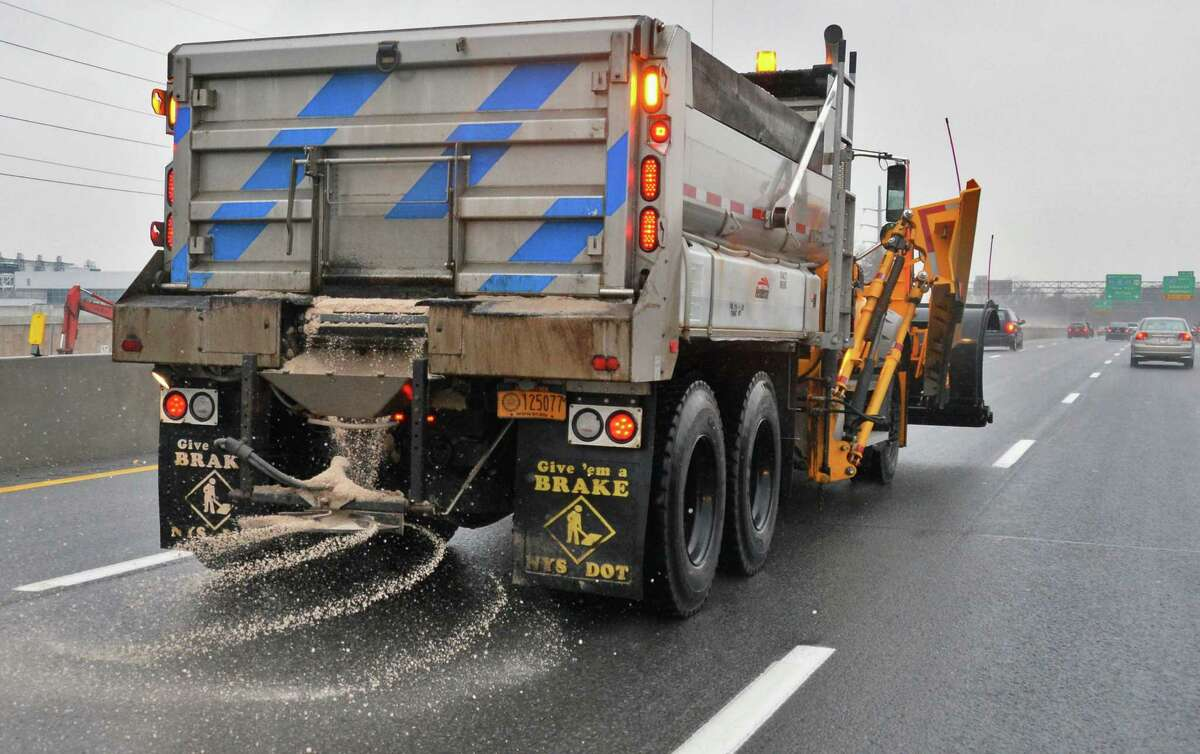 A state DOT snowplow spreads road salt on I-90 on Tuesday, Nov. 27, 2012, in Albany, N.Y. (John Carl D'Annibale / Times Union archive)