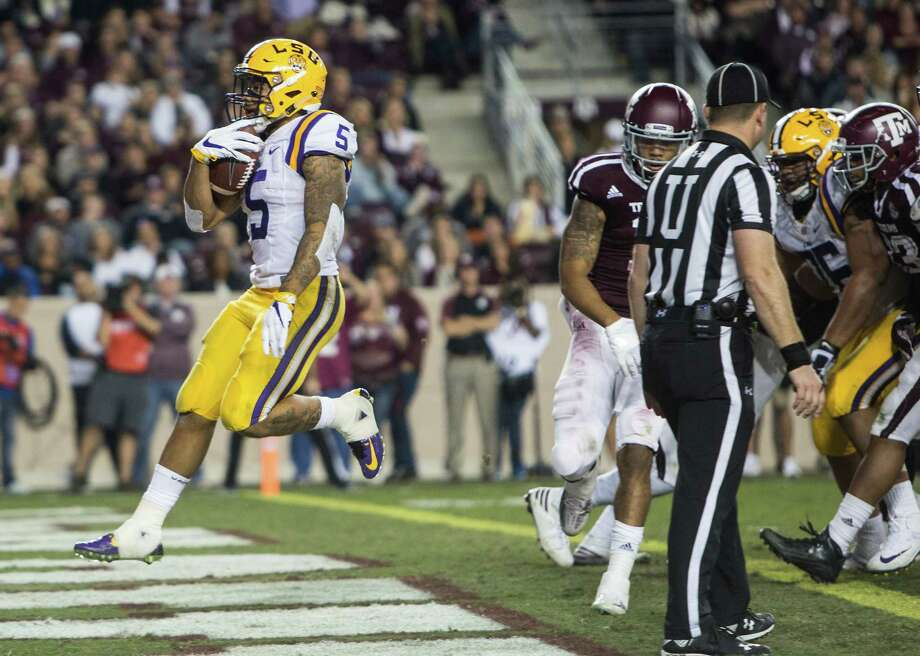 LSU running back Derrius Guice (5) runs into the end zone on a 6-yard touchdown run during the third quarter of an NCAA football game against Texas A&M at Kyle Field on Thursday, Nov. 24, 2016, in College Station. Photo: Brett Coomer, Houston Chronicle / © 2016 Houston Chronicle