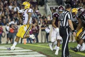 LSU running back Derrius Guice (5) runs into the end zone on a 6-yard touchdown run during the third quarter of an NCAA football game against Texas A&M at Kyle Field on Thursday, Nov. 24, 2016, in Houston.