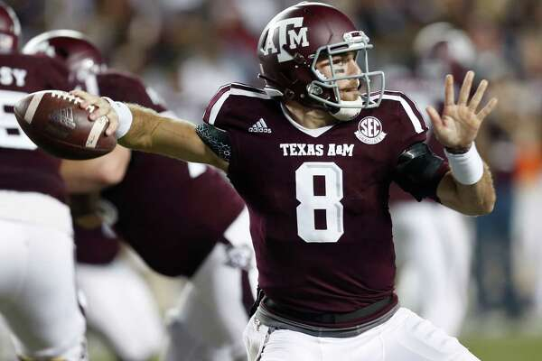 Texas A&M quarterback Trevor Knight (8) throws a pass against LSU during the third quarter of an NCAA football game at Kyle Field on Thursday, Nov. 24, 2016, in Houston.