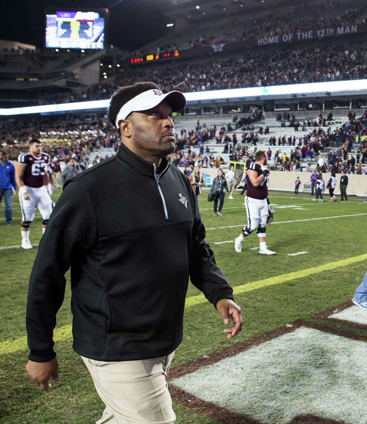 Texas A&M head coach Kevin Sumlin walks off the field after a 54-39 loss to LSU in an NCAA football game at Kyle Field on Thursday, Nov. 24, 2016, in Houston.
