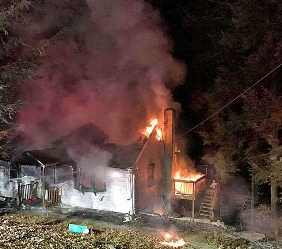 Fire heavily damaged a house at 15 Hemlock Trail in Oxford on Wednesday, Nov. 23, 2016. Photo: Citizens Engine Co. No. 2 Photo Via Facebook