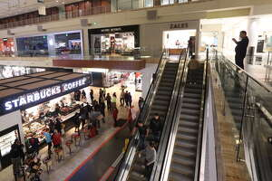 Shoppers are seen in the Galleria mall shortly after doors opened on Black Friday, at 6 am, Friday Nov. 25, 2016 in Houston.