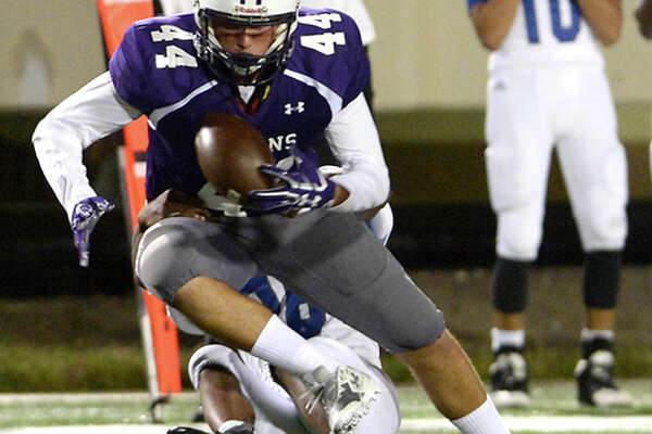 Port Neches-Groves' Holden Lane looks to keep hold of the ball on the pass as he is tackled from behind by Fort Bend Willowridge during Friday night's Class 5A Division II match-up at Stallworth Stadium in Baytown. Photo taken Friday, November 18, 2016 Kim Brent/The Enterprise