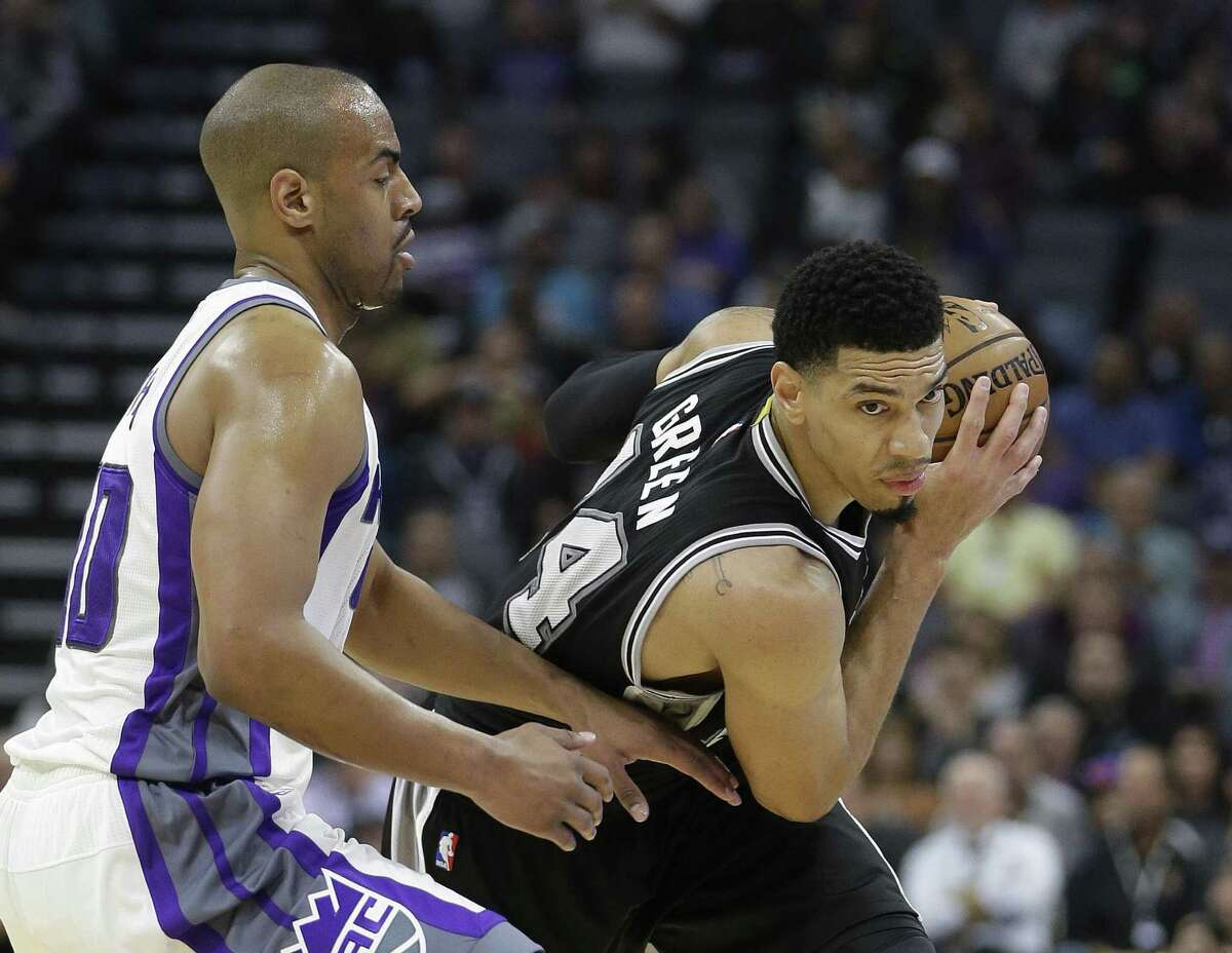 Danny Green protects the ball from Sacramento Kings guard Arron Afflalo on Nov. 16.
