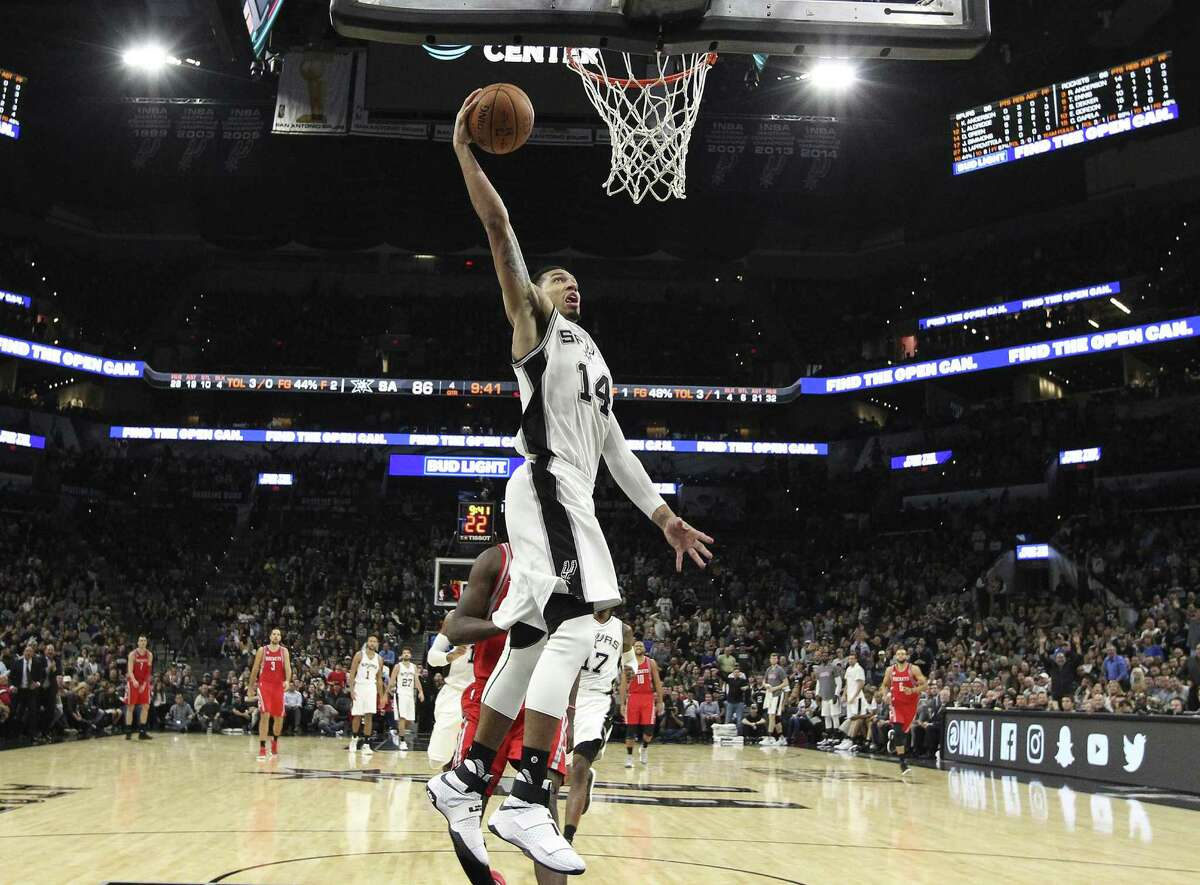 The Spurs' Danny Green goes up for a dunk during a preseason game against Houston on Nov. 9 at the AT&T Center.