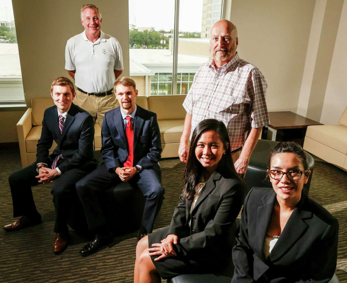 The REECycle team took on prestigious competitors and won for their rare earth recycling business plan. From left, seated, are Casey McNeil, left, Bobby Jacobs, Susan Tran and Cassandra Hoang, With them are Ken Ken Jones of the Wolff Center for Entrepreneurship and UH lecturer Jim Kane,