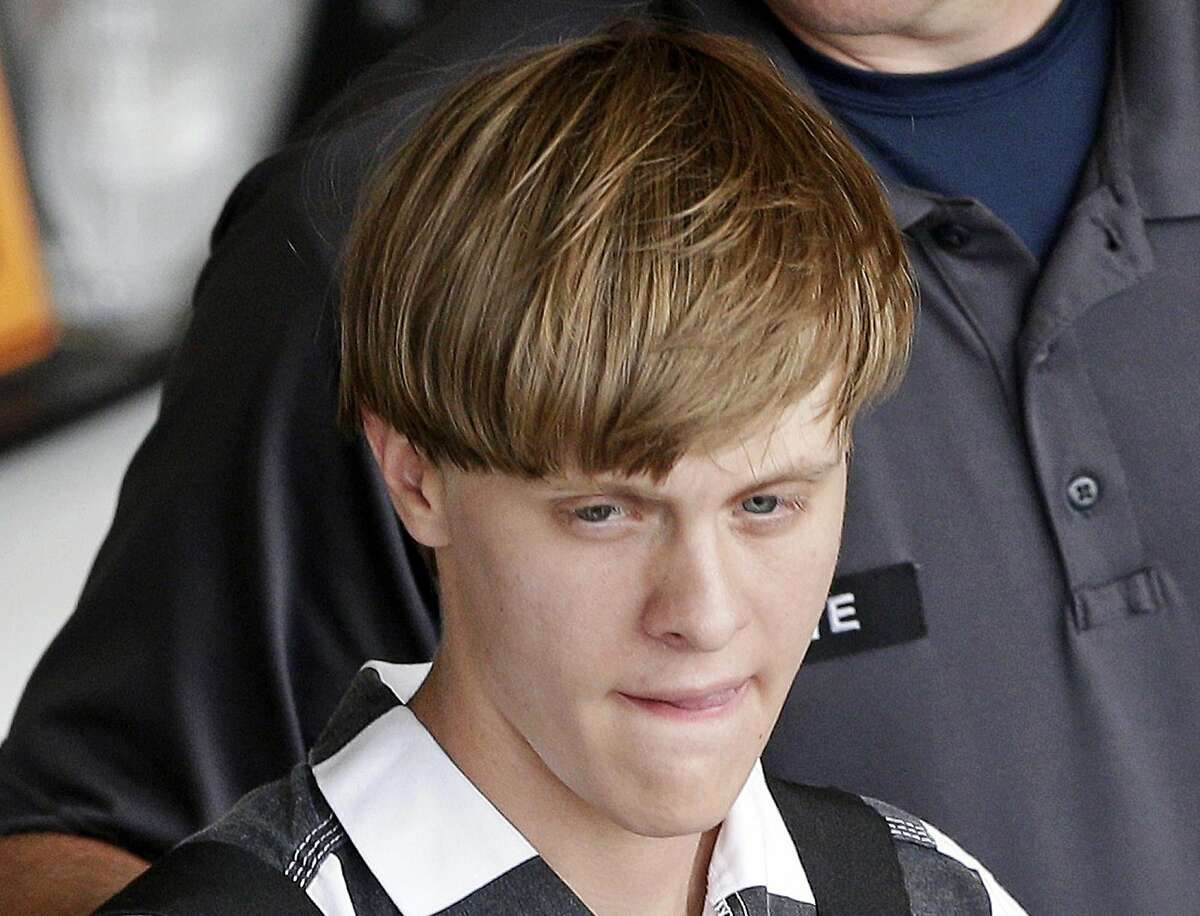 Charleston, S.C., shooting suspect Dylann Storm Roof is escorted from the Cleveland County Courthouse in Shelby, N.C., Thursday, June 18, 2015. Roof is a suspect in the shooting of several people Wednesday night at the historic The Emanuel African Methodist Episcopal Church in Charleston. (AP Photo/Chuck Burton)