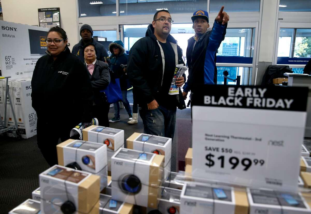 The doors are open at 8 a.m. for early bird shoppers that waited in line outside for Black Friday deals at the Best Buy in Emeryville, Calif. on Friday, Nov. 25, 2016.