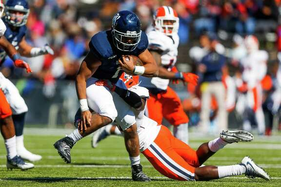Rice Owls running back Darik Dillard (1) runs through a tackle by UTEP Miners defensive back Devin Cockrell (27) as the Rice Owls take on the UTEP Miners at Rice Stadium Saturday, Nov. 19, 2016 in Houston. ( Michael Ciaglo / Houston Chronicle )