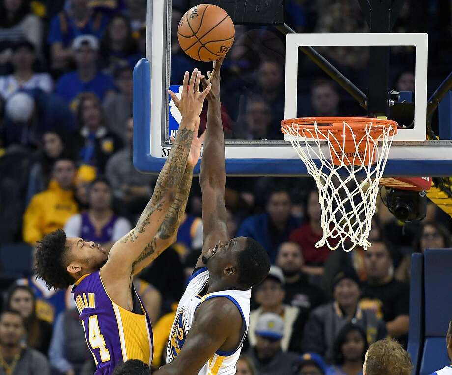 Draymond Green #23 of the Golden State Warriors goes up to defend the shot of Brandon Ingram #14 of the Los Angeles Lakers in the second half of their NBA basketball game at ORACLE Arena on November 23, 2016 in Oakland. Photo: Thearon W. Henderson, Getty Images