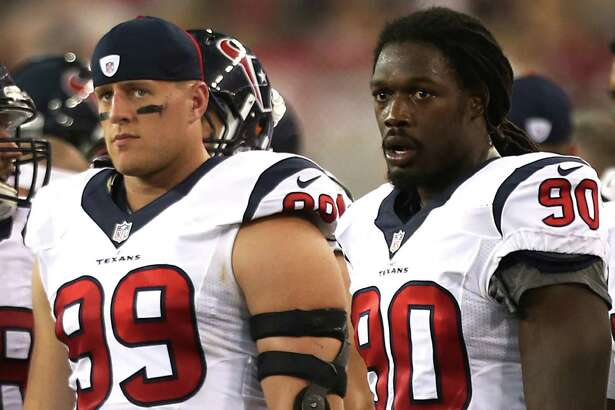 Houston Texans defensive end J.J. Watt (99) and  linebacker Jadeveon Clowney (90) stand on the sidelines during the second quarter of an NFL pre-season football game against the Arizona Cardinals at University of Phoenix Stadium Saturday, Aug. 9, 2014, in Glendale, Ariz. ( Brett Coomer / Houston Chronicle )