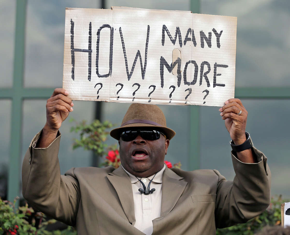 """Rev. Dr. Arthur Prioleau holds a sign during a protest in the shooting death of Walter Scott in North Charleston, S.C. """"They Can't Kill Us All"""" examines the spate of shootings that has sparked the Black Lives Matter movement."""