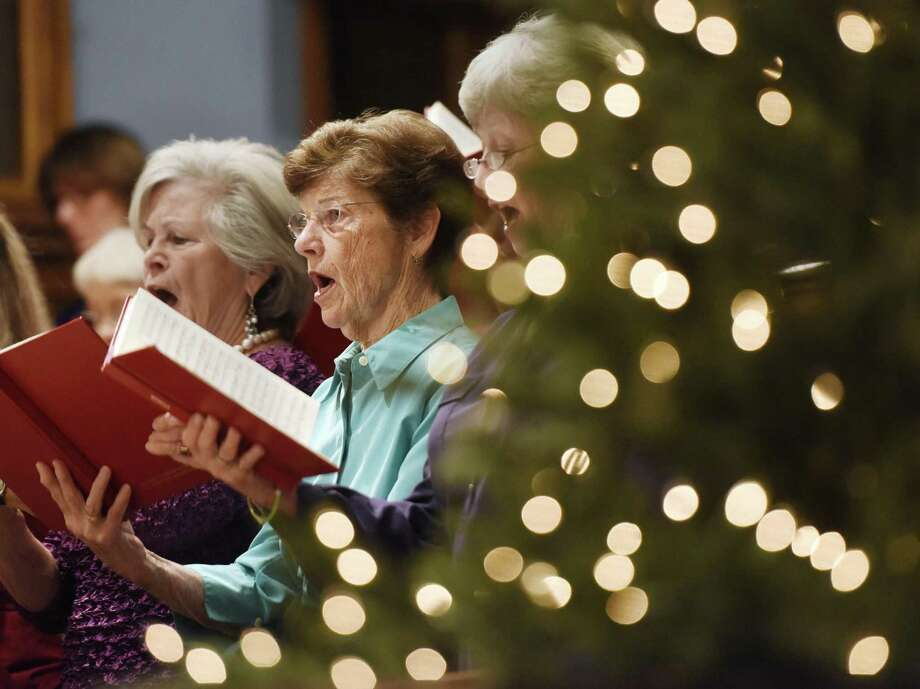 Nancy Pearson and other members of the First Church Festival Chorus sing during last year's performance of Handel's Messiah at First Congregational Church of Greenwich in Old Greenwich. The 50th anniversary of the performance will take place on Dec. 10 and both amateurs and professionals are invited to take part with rehearsals starting next week. Photo: Tyler Sizemore / Hearst Connecticut Media / Greenwich Time
