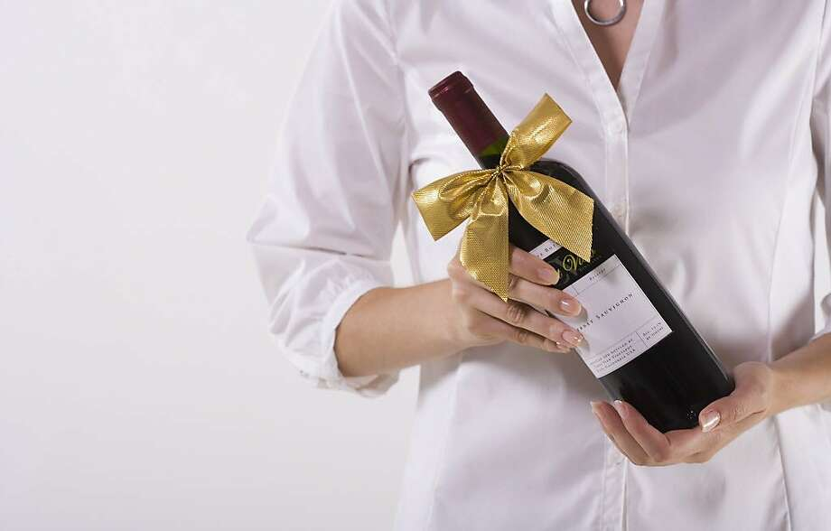A woman can't help offering alcoholic drinks as a gift. Photo: Jupiterimages, Getty Images
