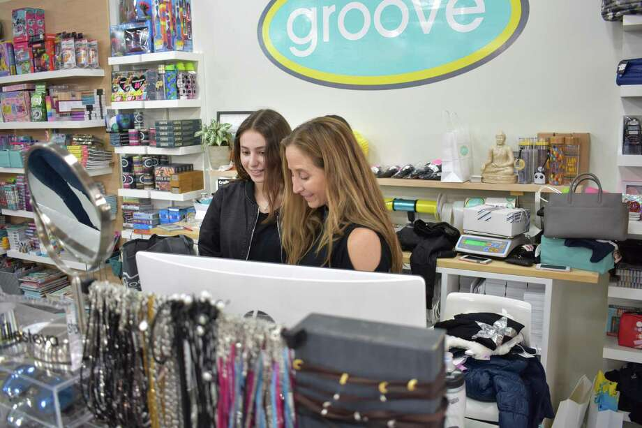 Corri Neckritz and daughter Amanda work the counter at Groove in Westport on Black Friday, Nov. 25, 2016. Neckritz said she expects to easily top her sales totals from 2015 for both the day and the season, in part due to having moved into larger space this year at 420 Post Rd. West. Photo: Alexander Soule / Hearst Connecticut Media / Stamford Advocate