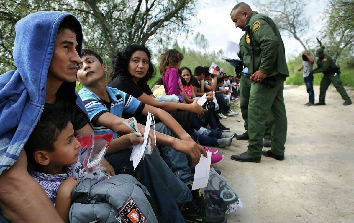Border Patrol officers question immigrants that had just crossed the Rio Grande River near Rincon Village south of Granjeno, TX, on Wednesday, Nov. 23, 2016.