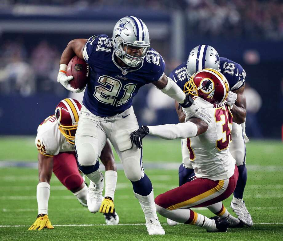 Dallas Cowboys running back Ezekiel Elliott (21) evades Washington Redskins safety Donte Whitner Sr. (39) in the fourth quarter on Thursday, Nov. 24, 2016 at AT&T Stadium in Arlington, Texas. (Richard W. Rodriguez/Fort Worth Star-Telegram/TNS) Photo: Richard W. Rodriguez, MBR / Fort Worth Star-Telegram