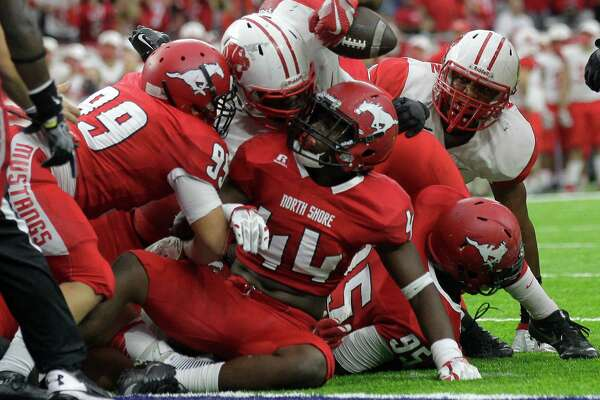 North Shore holds back a drive for a Katy touchdown from the two-yard line during Class 6A, Division I region semifinals at NRG Stadium on Friday, Nov. 25, 2016, in Houston. North Shore won the game 20-17.