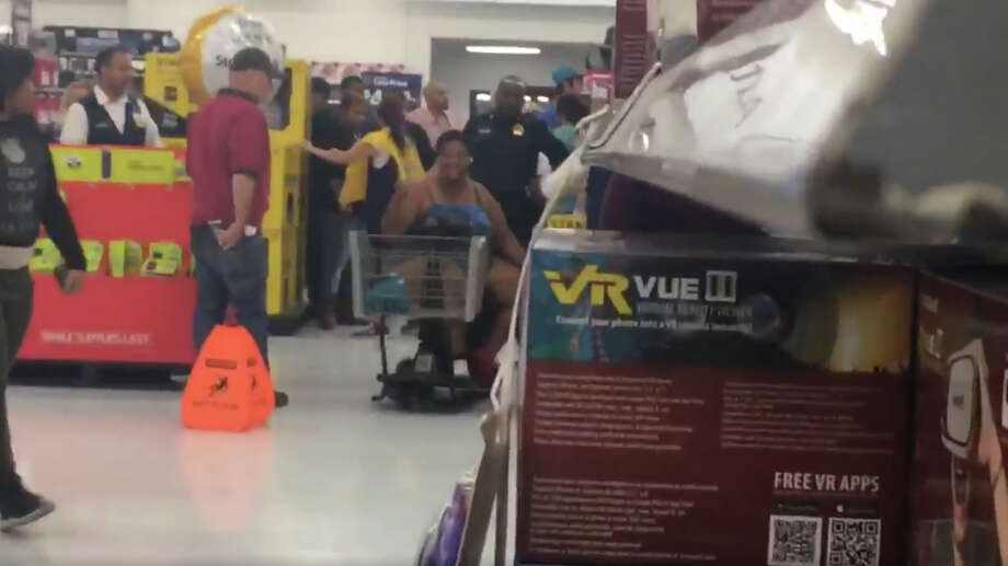 A shopper throws a tantrum at a Beaumont Walmart during the holiday shopping season. (Photo: Twitter)