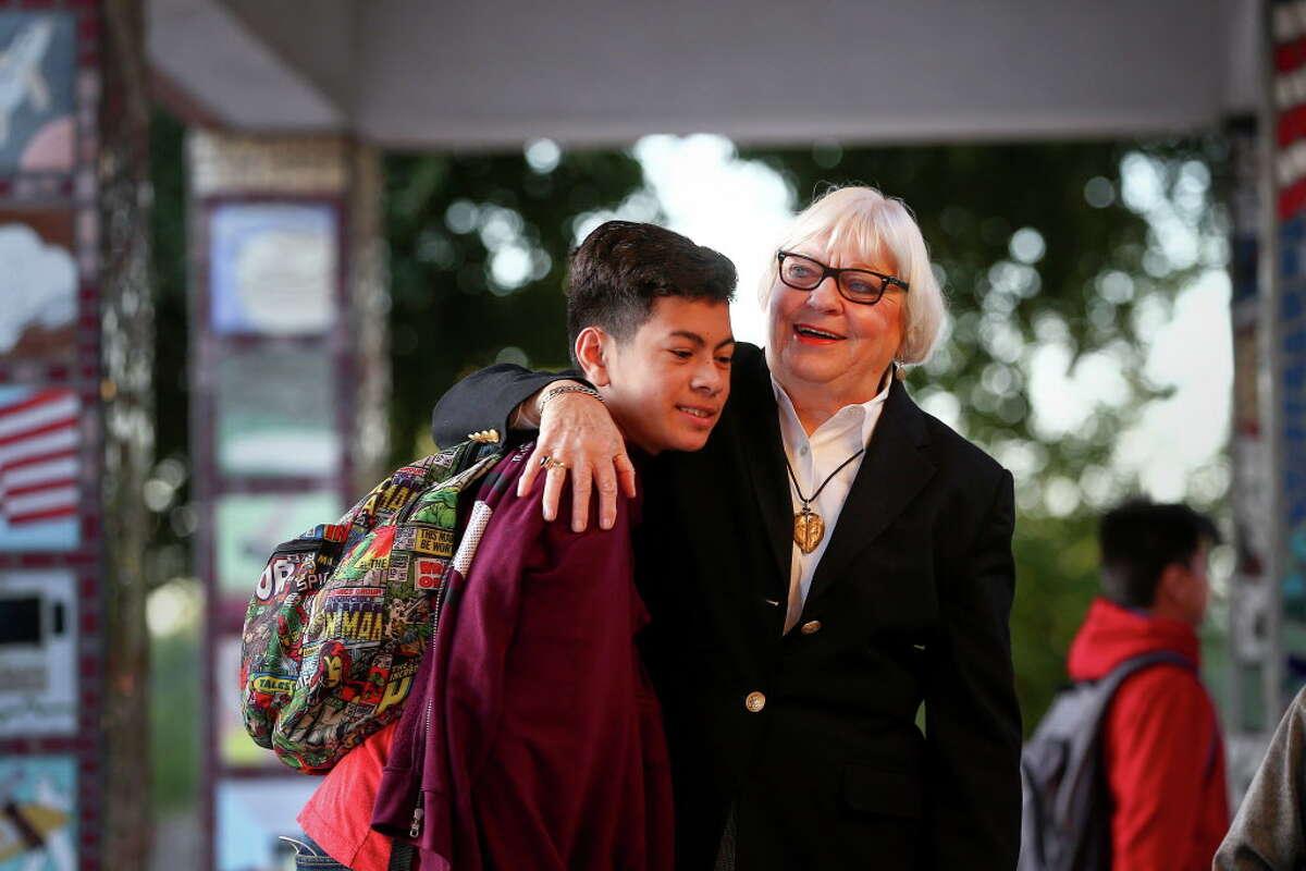 Dr. Bertie Simmons, the 82-year-old principal of Furr High School, hugs Ivan Hernandez, a freshman, before classes begin Friday, Sept. 30, 2016, in Houston.