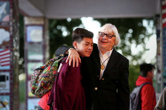 Dr. Bertie Simmons, the 82-year-old principal of Furr High School, hugs Ivan Hernandez, a freshman, before classes begin Friday, Sept. 30, 2016, in Houston.