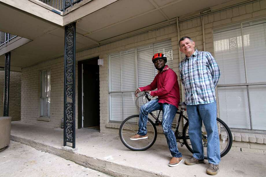 "Kenyan refugee Assumani Bakari, left, got a bike from Freewheels Houston. ""I thank God there are so many good people here,"" Bakari said recently. ""And I thank God I am still alive."" Photo: Pu Ying Huang / PU YING HUANG/PYHmedia"
