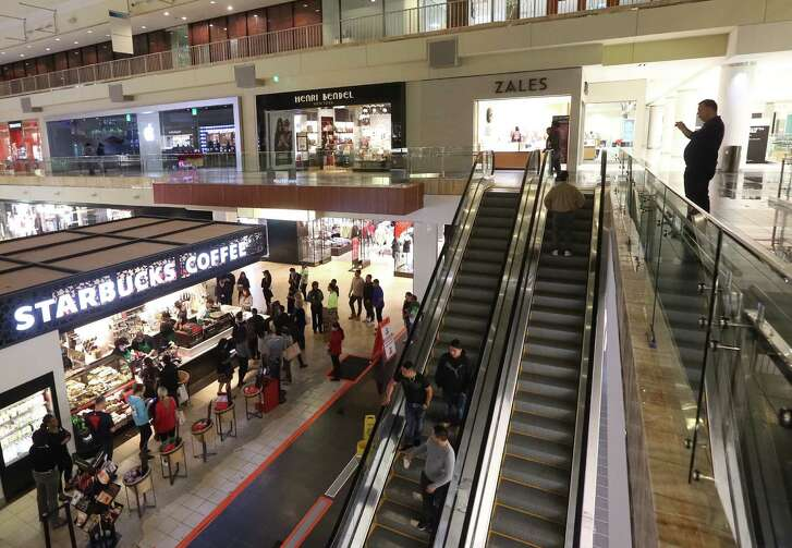 Shoppers are seen in the Galleria mall shortly after doors opened on Black Friday, at 6 am, Friday Nov. 25, 2016 in Houston. ( Jon Shapley / Houston Chronicle )