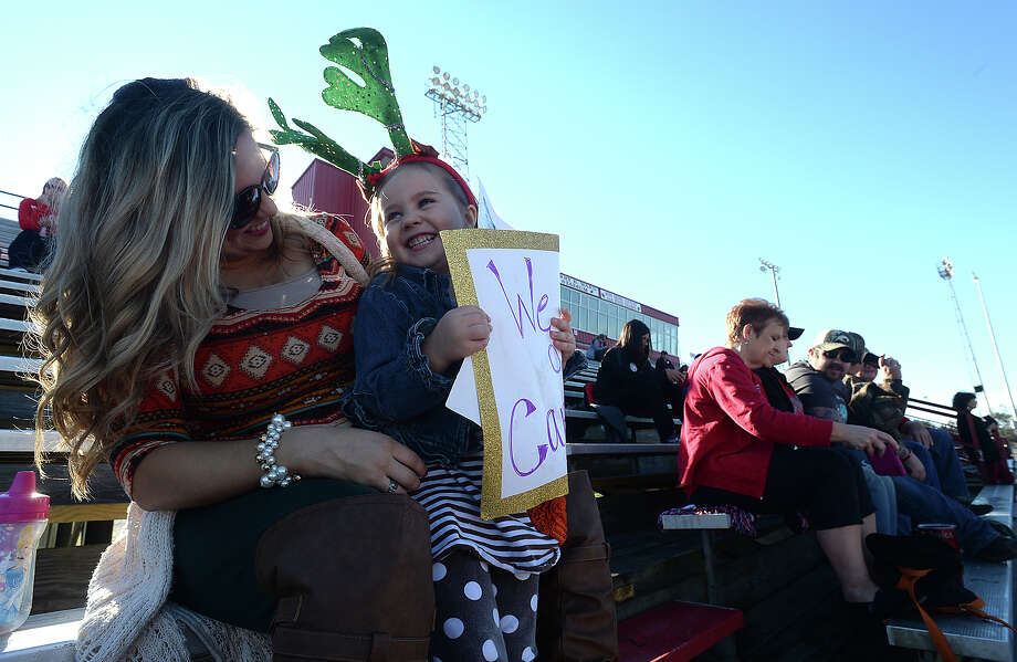 Teacher Falon Sheppard and her daughter Laurelai Wilhelm, 3, enjoy time together as they and members of the community settled into the stands with donuts and other sweets to take in a Thanksgiving morning football practice in Bridge City. The Cardinals were among the area teams offering the community a view of their practice as they continue to prepare for this week's playoff games. Photo taken Thursday, November 24, 2016 Kim Brent/The Enterprise Photo: Kim Brent / Beaumont Enterprise