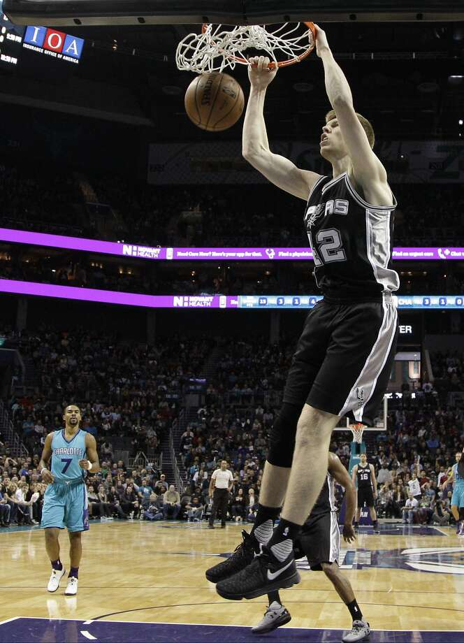 San Antonio's Davis Bertans (42) dunksagainst the Charlotte Hornets in the second half of an NBA basketball game in Charlotte, N.C., Wednesday, Nov. 23, 2016. The Spurs won 119-114. (AP Photo/Chuck Burton) Photo: Chuck Burton, Associated Press
