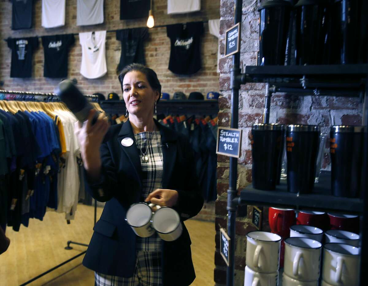 Mayor Libby Schaaf loads up on holiday gifts at Oaklandish for the Plaid Friday shopping campaign in Oakland, Calif. on Friday, Nov. 25, 2016, which is the city's effort to encourage people to patronize local businesses instead of big box retailers.