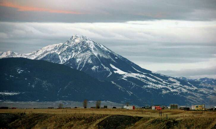 This Nov. 21, 2016 photo shows Emigrant Peak towering over the Paradise Valley in Montana north of Yellowstone National Park. U.S. officials on Monday, Nov.21, 2016 announced a ban on new mining claims across more than 30,000 acres in the area. (AP Photo/Matthew Brown)
