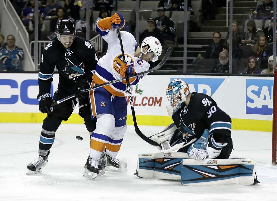 Backup Sharks goalie Aaron Dell, right, deflects a shot in the second period of Friday's matinee win. Photo: Marcio Jose Sanchez, Associated Press