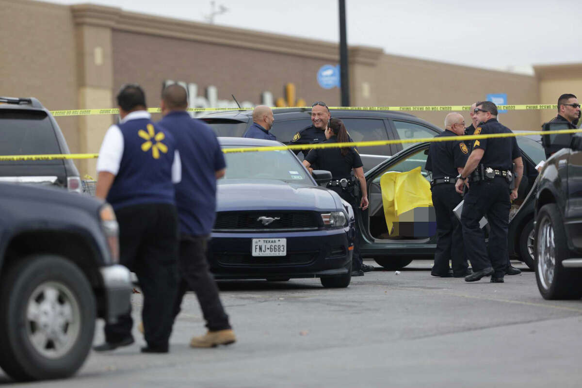 San Antonio police investigate the scene of a shooting with a person killed in the Walmart parking lot on Vance Jackson, Friday Nov. 25, 2016.