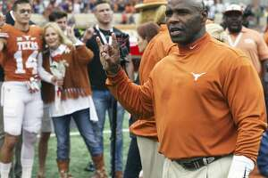 Longhorn coach Charlie Strong hears the school song as he  leads his team against TCU at DKR Stadium on November 25, 2016.
