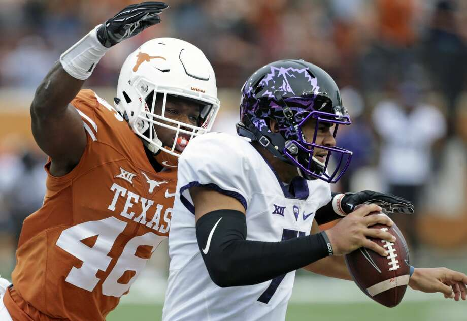 Linebacker Malik Jeffeson gets in to sack quarterback Kenny Hill as Longhorn coach Charlie Strong leads his team against TCU at DKR Stadium on November 25, 2016. Photo: Tom Reel/San Antonio Express-News