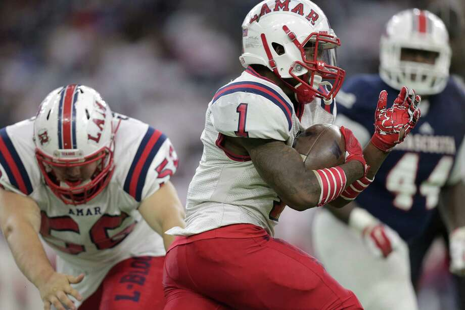 Lamar's Ta'Zhawn Henry (1) runs the ball during the first half of Class 6A, Division I region semifinals against Atascocita at NRG Stadium on Friday, Nov. 25, 2016, in Houston. Photo: Elizabeth Conley, Houston Chronicle / © 2016 Houston Chronicle